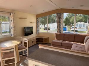 A seating area at Poppy at Oakdene Forest Park