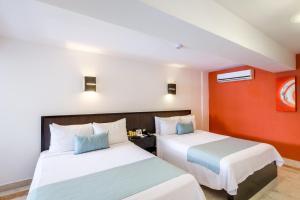 Een bed of bedden in een kamer bij Illusion Boutique Hotel By Xperience Hotels