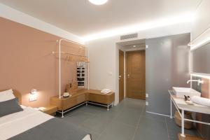 A bathroom at Mandraki Village Boutique Hotel