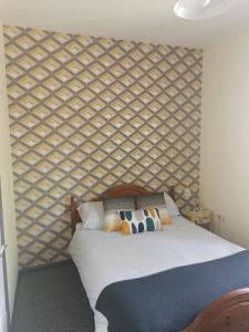 A bed or beds in a room at The Poacher Portishead