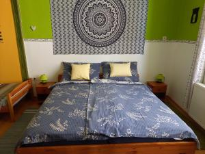 A bed or beds in a room at Gábor Vendégház