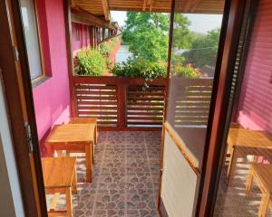 A balcony or terrace at Pension Delta Miraj