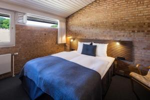En eller flere senge i et værelse på Comwell Klarskovgaard