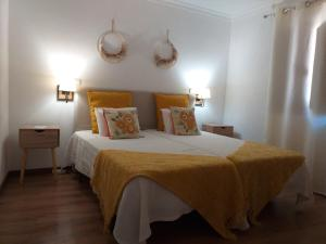 Uma cama ou camas num quarto em Meimoa Guesthouse