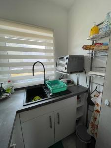 A kitchen or kitchenette at Maggies-Apartment-Hannover