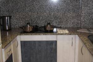 Una cocina o zona de cocina en Aparthotel Marsol