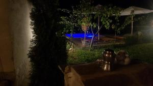 Изглед към басейн в The 1st Guest House in Kyustendil - Guest Villa - Casa Rosa - Suitable for Families, Friends, Relax, Sport Enthusiasts and Travel Addicts или наблизо