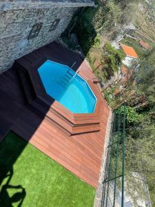 The swimming pool at or near Casa da Encosta Douro Valley