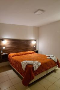 Una cama o camas en una habitación de Cable Carril