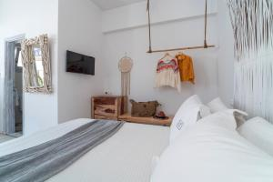 A bed or beds in a room at F Charm Hotel - Adults Only