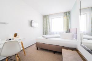 Ein Bett oder Betten in einem Zimmer der Unterkunft Hotel Kaspar Garni