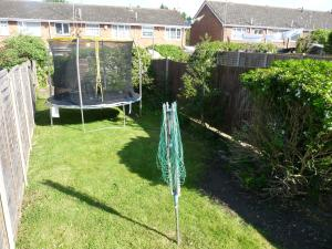 A garden outside Victoria Road, comfortable 3 bedroom houses with fast Wi-Fi