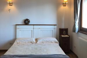 Letto o letti in una camera di La Poulerie - Suite Dépendance