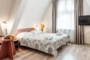 Łóżko lub łóżka w pokoju w obiekcie Hotel Cis
