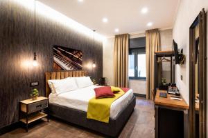 Letto o letti in una camera di casajammone naples b&b