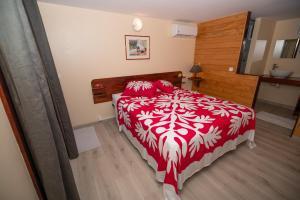 Cama ou camas em um quarto em BORA BORA HOLIDAY'S LODGE