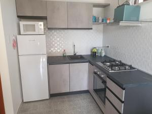 A kitchen or kitchenette at Amazing apartment in Villa on Cilento coast