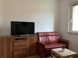 A television and/or entertainment center at La- Apartment