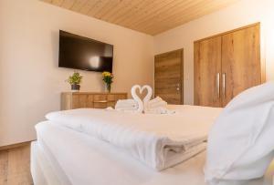 Posteľ alebo postele v izbe v ubytovaní Villa Gloria Rooms & Apartments