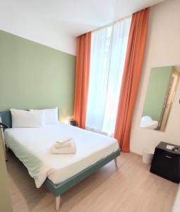 A bed or beds in a room at Camplus Guest Bernini Casa per Ferie