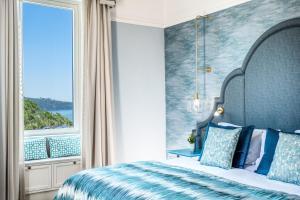 Un ou plusieurs lits dans un hébergement de l'établissement Hotel Mediterraneo