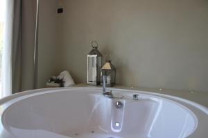 A bathroom at La Locanda Del Pontefice - Luxury Country House