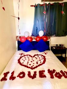 A bed or beds in a room at Higuey Center City