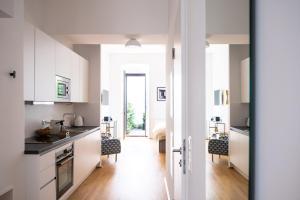 Küche/Küchenzeile in der Unterkunft The BL42 - Vienna Concept Apartments