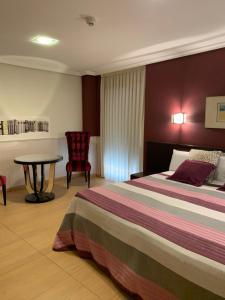 Cama o camas de una habitación en Hostal El Lechuguero