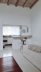 A kitchen or kitchenette at Pousada Lacosta