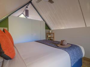 A bed or beds in a room at Emma Gorge Resort at El Questro