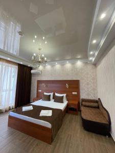 Кровать или кровати в номере Гостиница Арагац 2