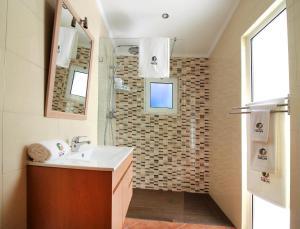 A bathroom at Resort Natura