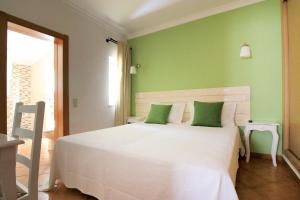 A bed or beds in a room at Resort Natura
