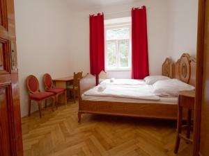 Łóżko lub łóżka w pokoju w obiekcie Capsule Hostel Prague