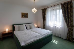 Кровать или кровати в номере Zámeček Pod Hradem