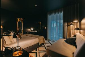 Een bed of bedden in een kamer bij Torel Avantgarde