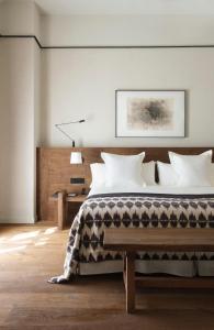 Łóżko lub łóżka w pokoju w obiekcie Can Ferrereta