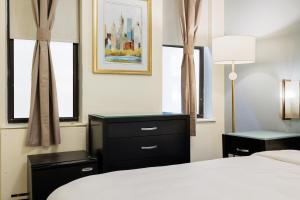 A bed or beds in a room at The Duffy Times Square by Kasa