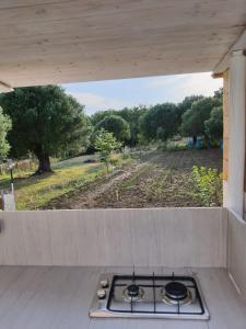 A kitchen or kitchenette at Palinuro Casa Vacanza Melita