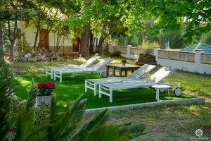 A garden outside Finca Soñada - Nudist Resort