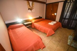 A bed or beds in a room at La Puerta del Sol