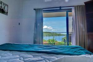 Cama o camas de una habitación en Condovac La Costa All Inclusive