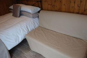 A bed or beds in a room at Malthouse Farm Carriage