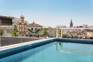 The swimming pool at or near Radisson Collection Hotel, Magdalena Plaza Sevilla