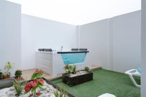 The swimming pool at or close to Exclusive Penthouse with Private Rooftop Jacuzzi by Simply Comfort