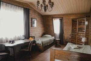 A bed or beds in a room at Guesthouse Voskresenie
