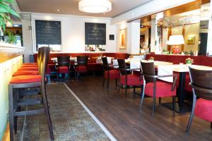 A restaurant or other place to eat at Hotel Restaurant Esser