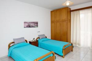 A bed or beds in a room at Maria Studios & Apartments