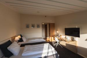En eller flere senge i et værelse på Hotel Sonderborg Strand; Sure Hotel Collection by Best Western